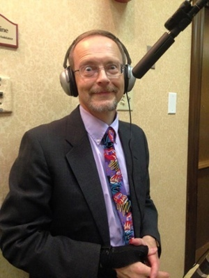 Executive Producer, Peter Stassa, standing at the camera with headphones on