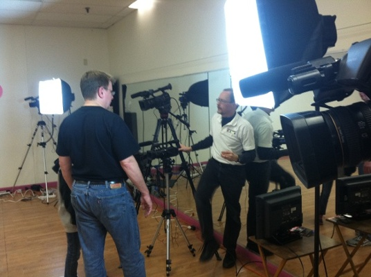 Executive Producer, Peter Stassa, and crew on set of a training video for Hydro Family Fitness