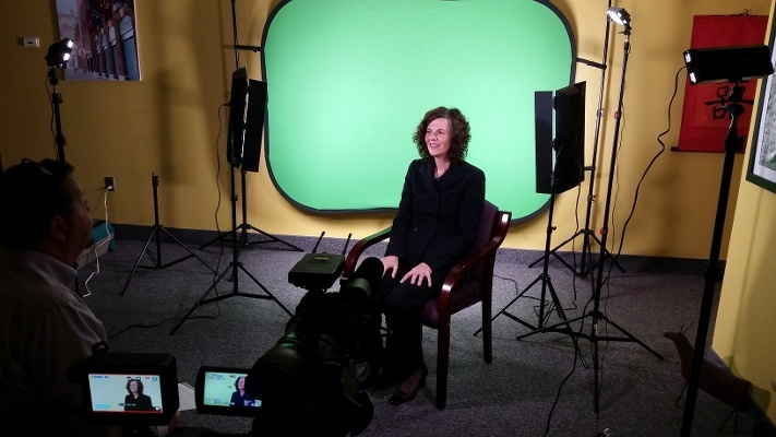 On set of a testimonial video shoot for Centage, shooting on green screen