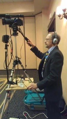 Executive Producer, Peter Stassa, filming with headphones on to monitor audio.
