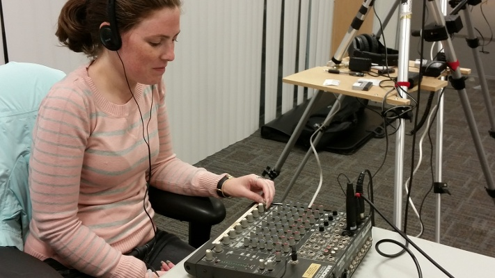 Lead Editor and Creative Director, Candice Moore, monitoring audio at a shoot for SimpliVity's employee orientation